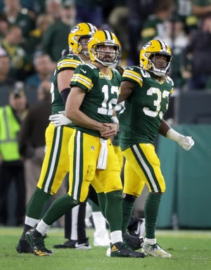 Packers quarterback Aaron Rodgers (12) leaves the field after being sacked last Thursday against the Philadelphia Eagles