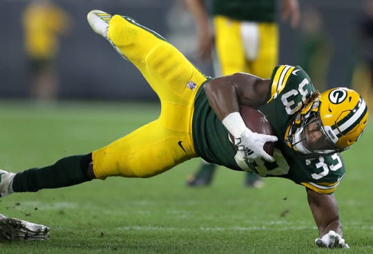 Green Bay Packers running back Aaron Jones (33) against the Philadelphia Eagles during their football game Thursday, September 26, 2019, at Lambeau Field in Green Bay, Wis. The Eagles defeated the Packers 34 to 27.