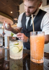 Assistant manager and bartender Dalton Kenley prepares cocktails at The Kennedy in downtown Pensacola on Friday.