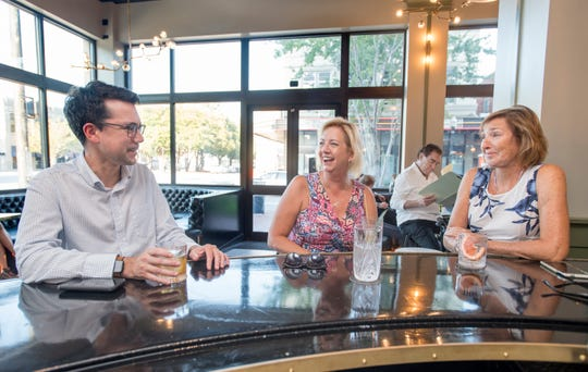 From left, Kristopher Castillo, Linda Baker and Julie Azuma enjoy a drink Friday at The Kennedy in downtown Pensacola.