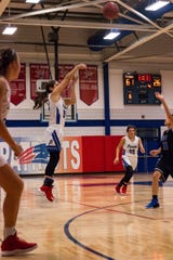Pace senior Makayla Michael (center) shoots during an undated game against Bay High School. Michael committed to play for the University of West Florida on Wednesday.