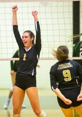 Delone Catholic's Maddie Clabaugh (1) celebrates a point in the third set against York Catholic in a YAIAA Division III volleyball match in McSherrystown on Thursday, Sept. 26, 2019. The Squirettes won in four sets, 21-25, 25-19, 25-18, 25-15.