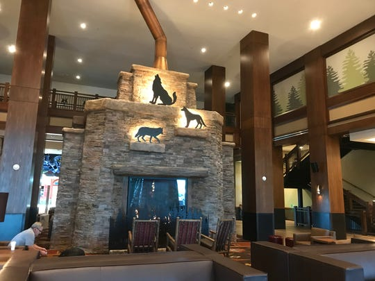 A large stone fireplace greets visitors to the lobby of Great Wolf Lodge in Scottsdale.