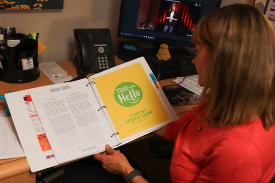 Elizabeth Cling, a CARE 7 Youth Specialist with the city of Tempe, looks through a book on Sept. 26, 2019 with suicide prevention resources CARE 7 staff will be introducing to students throughout the school year.