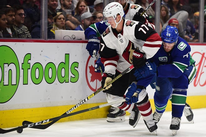 Sep 26, 2019; Vancouver, British Columbia, CAN;Vancouver Canucks forward Tyler Graovac (44) reaches for the puck against Arizona Coyotes defenseman Victor Soderstrom (77) during the first half at Rogers Arena. Mandatory Credit: Anne-Marie Sorvin-USA TODAY Sports