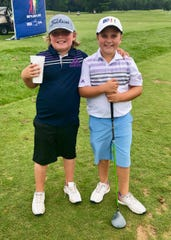 Twin brothers Ryder and Brody VanDrew are only 8 years old but love golfing like their father, Brett.