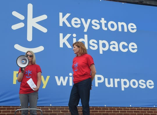 Jessica Brubaker (left) and Jennifer Tansey (right) speak to the crowd during the Keystone Kidspace groundbreaking ceremony on Friday, Sept. 27, 2019.