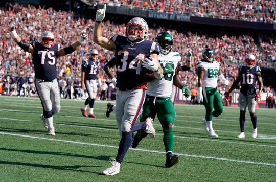 New England Patriots running back Rex Burkhead (34) celebrates his touchdown run against the New York Jets last week.