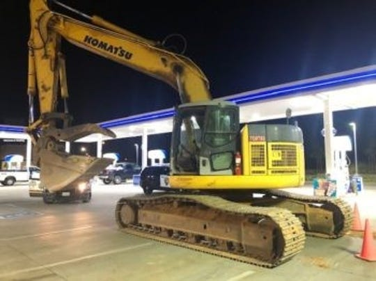 This is the excavator that police said was stolen from a nearby construction site and driven into the overhang at the ARCO station in south Redding on Friday, Sept. 27, 2019.