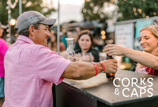 A customers gets a beer at the Corks and Caps event in Brownwood, Texas.