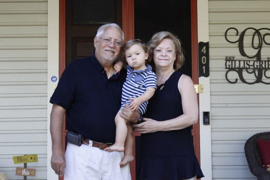 Charleen and John Burik stand with great-nephew Anthony Vincent in front of the historic Gillis-Grier House in Salisbury on Sept. 27.