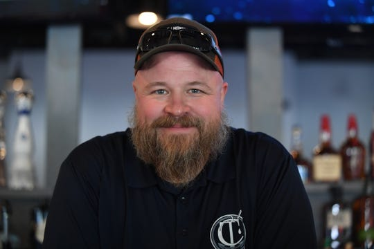 Lincoln Rogerson stands inside Coastal Taproom, his new tavern on Route 24 along with co-owner Cassie Rogerson. Sept. 26, 2019.