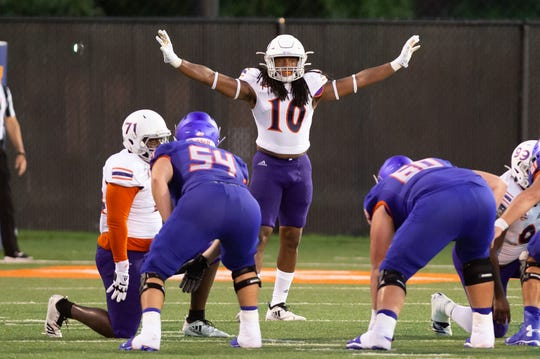 Northwestern State inside linebacker Ja'Quay Pough signals to his teammates during a Sept. 21 game at Houston Baptist.