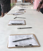 Volunteers collect signatures in a petition drive at Western Hill Baptist Church on Thursday, Sept. 26, 2019.