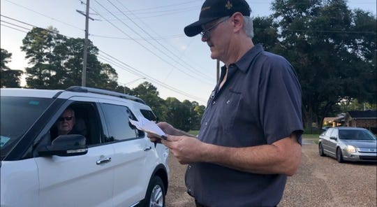 Volunteer and West Shreveport resident Robert Brill collect signatures in a drive-thru petition drive at Western Hill Baptist Church on Thursday, Sept. 26, 2019.