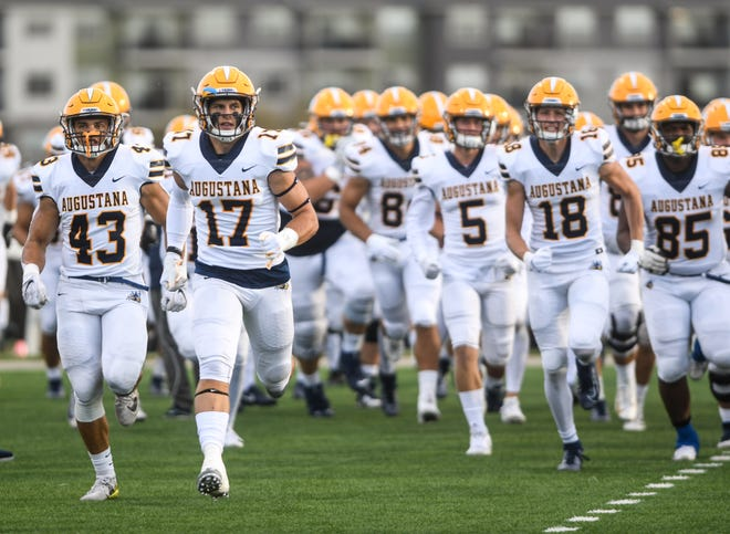 "Augustana runs onto the field before the ""Key to the City"" game at Bob Young Field on Thursday, Sept. 26, 2019."