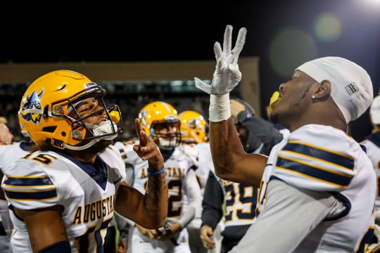 """Augustana defensive back Dameon Moser (15) and corner back Kenneth Griffin (26) celebrate a win after the """"Key to the City"""" game at Bob Young Field on Thursday, Sept. 26, 2019."""