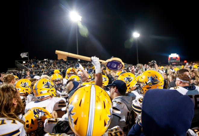 """Augustana celebrates a win against USF after the """"Key to the City"""" game at Bob Young Field on Thursday, Sept. 26, 2019."""