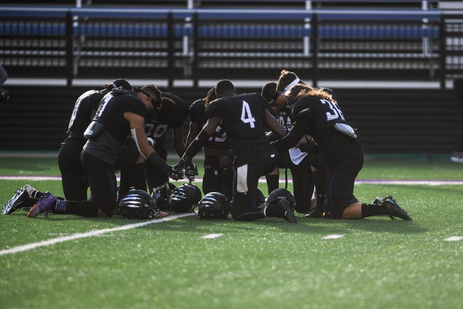 """USF players pray before the """"Key to the City"""" game at Bob Young Field on Thursday, Sept. 26, 2019."""