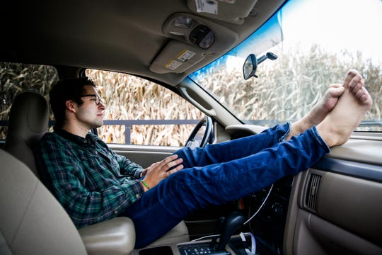 Nathan Downs of Sioux Falls drives barefoot during the summer. Downs believes that it is easier to use gloves rather than mittens, and it is easier to drive barefoot than with shoes on.