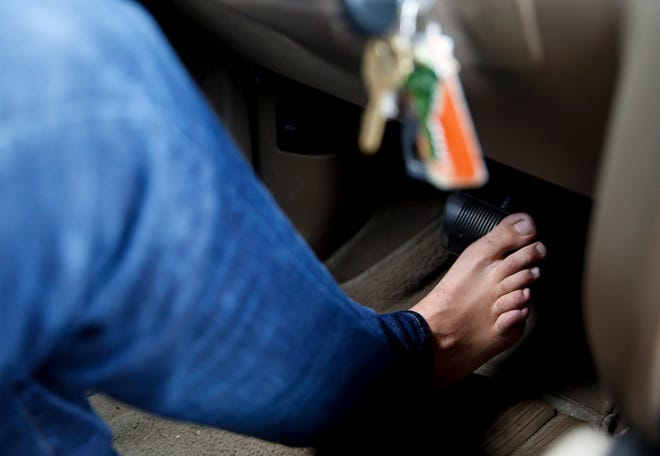 Nathan Downs of Sioux Falls drives barefoot during the summer. Downs believes driving barefoot allows him to have better control of the pedals.