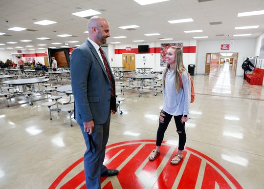 Reeds Spring Superintendent Cody Hirschi talks with high school student Alexandra Steed, 16, as he walks through the school on Thursday, Sept. 12, 2019.