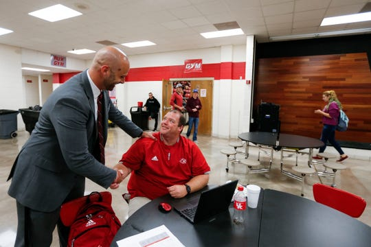 Reeds Spring Superintendent Cody Hirschi talks with high school football coach Jared Anderson as he walks through the school on Thursday, Sept. 12, 2019.