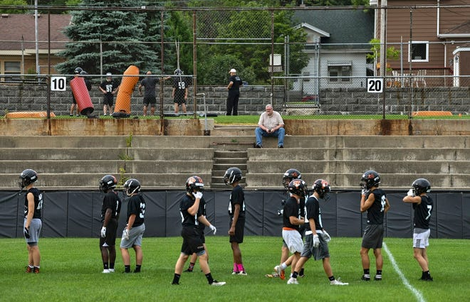 Long-time St. Cloud Times sports writer Tom Elliott watches this season's St. Cloud Tech football team practice in August at Clark Field. Elliott, who started at the Times in 1982, is leaving the paper.