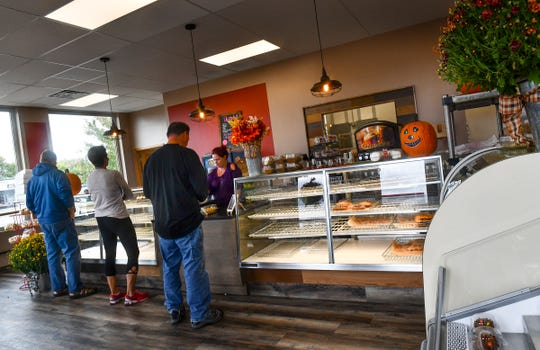 Customers line up for fresh goods at the new Dutch Maid Bakery location Friday, Sept. 27, in Sauk Rapids.