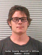 """FILE - In this undated photo released by the Cache County Sheriff's Office shows Christopher Richard Poulson in Logan, Utah.  Poulson, who pleaded guilty to killing his girlfriend and her son has been sentenced to at least 16 years to life in prison.  Poulson said Thursday, Sept. 26, 2019, during a hearing that he feels terrible for the deaths of 23-year-old Emily Quijano and her 3-year-old son Gabriel Almiron and was not in his """"right mind"""" when he killed them. (Cache County Sheriff's Office via AP, File)"""