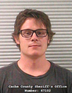 "FILE - In this undated photo released by the Cache County Sheriff's Office shows Christopher Richard Poulson in Logan, Utah.  Poulson, who pleaded guilty to killing his girlfriend and her son has been sentenced to at least 16 years to life in prison.  Poulson said Thursday, Sept. 26, 2019, during a hearing that he feels terrible for the deaths of 23-year-old Emily Quijano and her 3-year-old son Gabriel Almiron and was not in his ""right mind"" when he killed them. (Cache County Sheriff's Office via AP, File)"