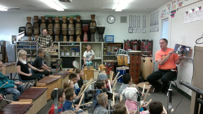 Curtis Payne, at the time a music specialist at Sunset Elementary School in St. George, leads students in a lesson involving instruments and a book-reading in this file photo from 2012.