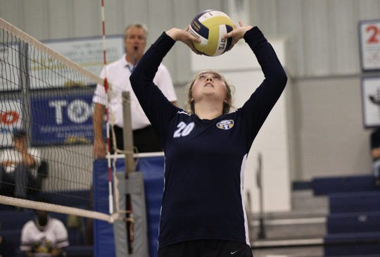 CCS senior Kaylen Vincent sets a pass as St. John Paul II's volleyball team rallied from down 0-2 to pull out a 3-2 home victory over Community Christian on Thursday, Sept. 26, 2019.