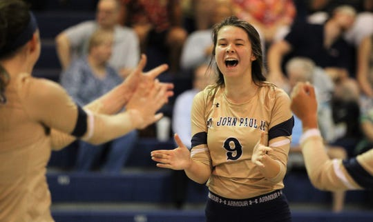 St. John Paul II sophomore Sam Taylor celebrates a point as the Panthers'  volleyball team rallied from down 0-2 to pull out a 3-2 home victory over Community Christian on Thursday, Sept. 26, 2019.