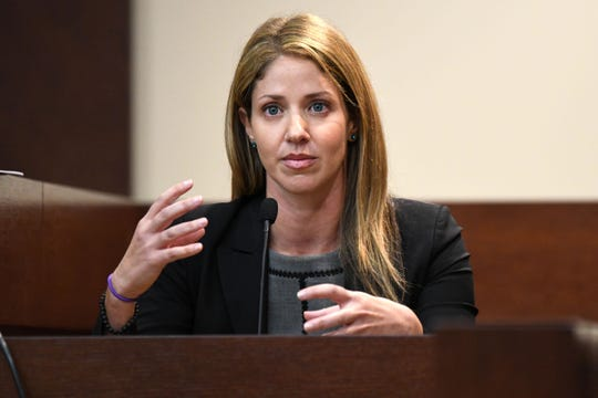 Wendi Adelson, the ex-wife of Florida State law professor Dan Markel, who was shot and killed in 2014, gestures as she responds to a question.