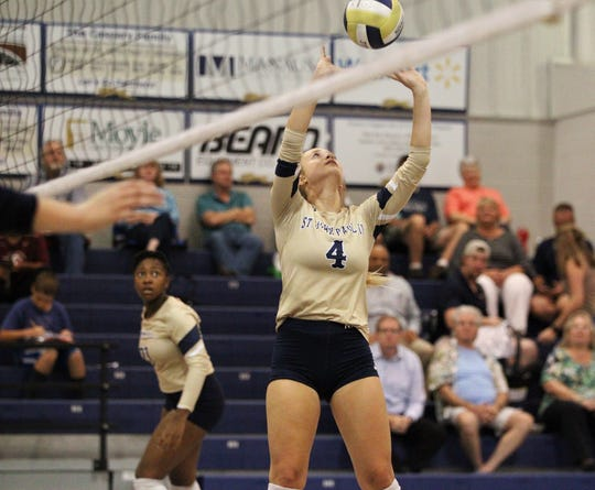 St. John Paul II sophomore Caitlin O'Connor sets a ball as the Panthers' volleyball team rallied from down 0-2 to pull out a 3-2 home victory over Community Christian on Thursday, Sept. 26, 2019.