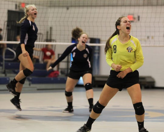 CCS libero Faith Fuller and her team celebrate a point as St. John Paul II's volleyball team rallied from down 0-2 to pull out a 3-2 home victory over Community Christian on Thursday, Sept. 26, 2019.