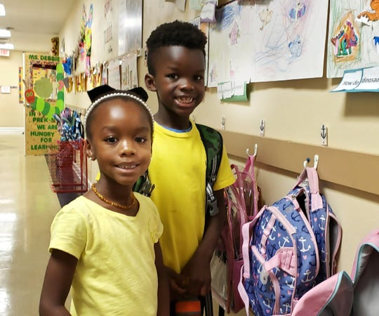 St. Andrew's Episcopal Academy students Aden and Ari Jones wear the colors of the Bahamian flag on Sept. 6, 2019.