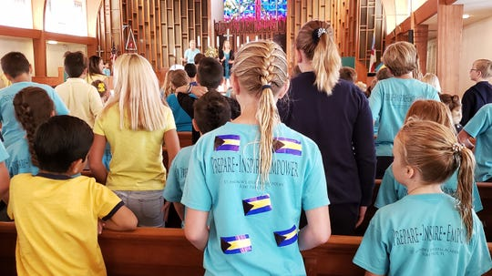 St. Andrew's Episcopal Academy students wear the colors of the Bahamian flag on Sept. 6, 2019. The school raised $5,000 that day, which was donated to the Anglican Diocese of the Bahamas, Turks and Caicos to aid victims of Hurricane Dorian.