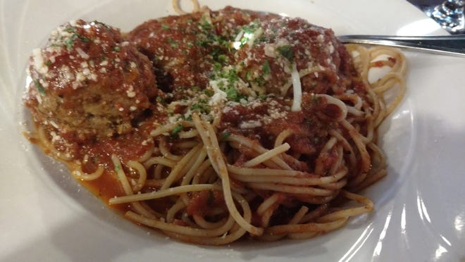 Just a bite of The Italian Cousin's comfort food, spaghetti and meatballs, transported me to a simpler time.