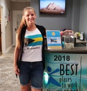 St. Andrew's Episcopal Academy math teacher Alyssa Fitzgerald wears a Bahamian flag T-shirt while helping raise $5,000on Sept. 6, 2019 at the Fort Pierce school. The money was donated to the Anglican Diocese of the Bahamas, Turks and Caicos to aid victims of Hurricane Dorian.
