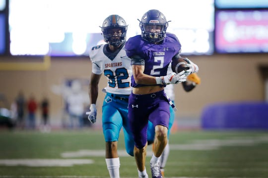 Eastlake's Blas Compean completes a pass and scores a touchdown against Pebble Hills during the game Thursday, Sept. 26, at the SISD Student Activities Complex in El Paso.