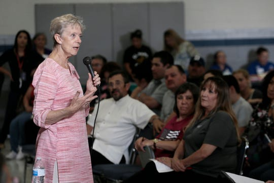 Stephanie Karr, One Fund El Paso coordinator,  speaks to victims and family members of victims of the Walmart mass shooting during a Sept. 26, 2019, town hall meeting.