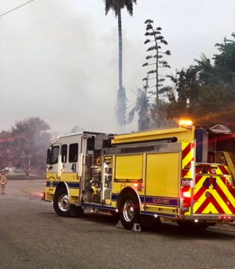 Fire burns trees, fence outside Simi Valley home
