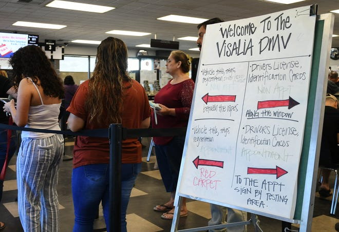 Customers line up at the Visalia DMV, which reopened on Friday after mold was found in the building earlier this month.