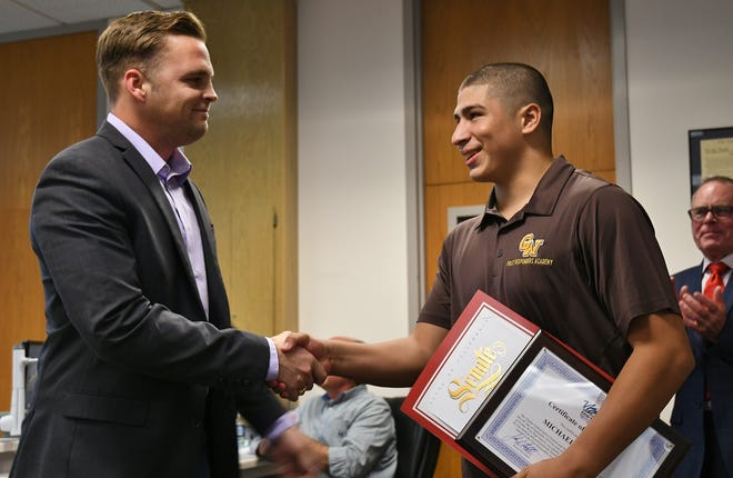 Golden West sophomore Michael Falcon was awarded at this week's Visalia Unified trustees meeting for saving a fellow student's life.