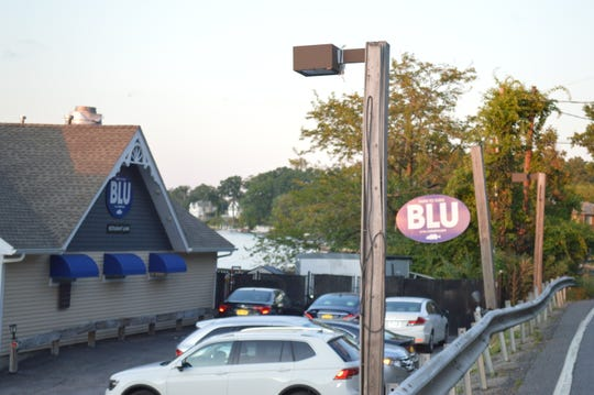 Blu at the Lakehouse restaurant continues to operate with Mike Barile's unauthorized sewer connection.