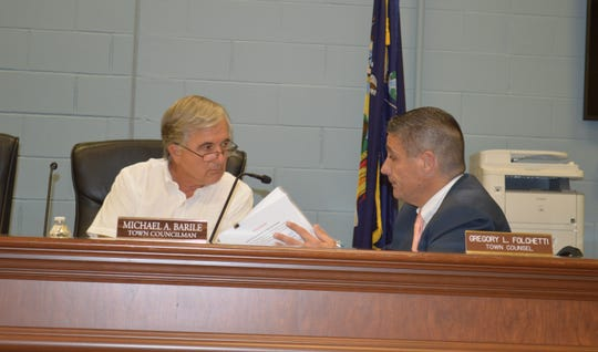 Carmel Town Board member Mike Barile, left, confers with Town Counsel Greg Folchetti, who has recused himself from representing the town in an action against Barile.