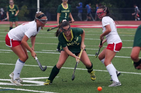 Lakeland's Jenna McCrudden (14) gets between Somers' Nieve Manhood (5) and Nadia Pannella (4) during field hockey action at Somers High School Sept. 26, 2019. Lakeland won the game 9-0.