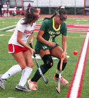 Lakeland's Lauren Salazar (16) and Somers' Nieve Mahood (5) battle for ball control during field hockey action at Somers High School Sept. 26, 2019. Lakeland won the game 9-0.